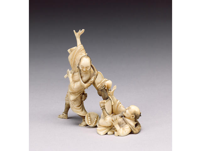 An animated stained ivory okimono,