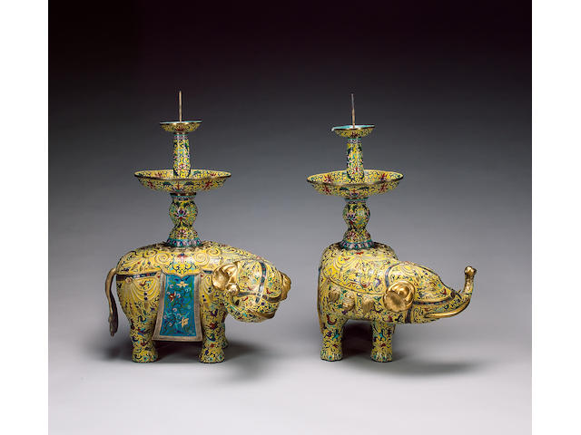 A very decorative pair of yellow-ground, cloisonné enamel elephants;