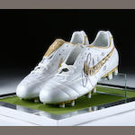A pair of Ronaldinho signed boots