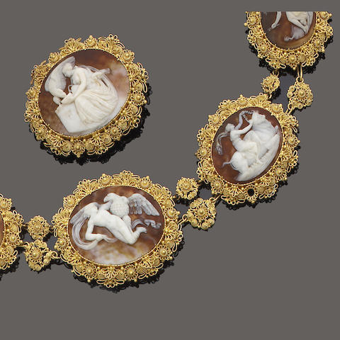 An early 19th century gold and shell cameo necklace, brooch and earring suite,