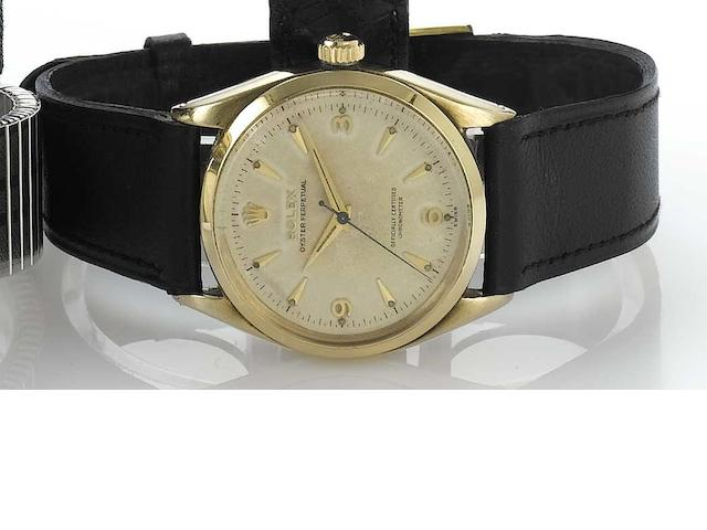 Rolex. A 9ct gold centre seconds automatic wristwatch  Ref:6564, Glasgow Import mark for 1955