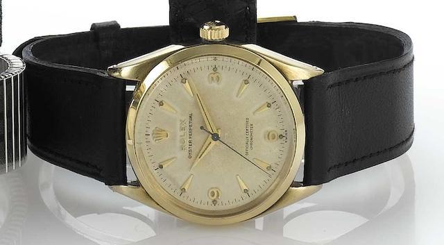 Rolex. A 9ct gold centre seconds automatic wristwatch  Ref:6564, Glasgow Import mark for 1955