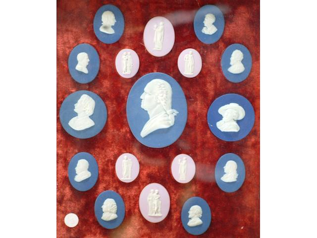 A framed set of seventeen Wedgwood style portrait medallions