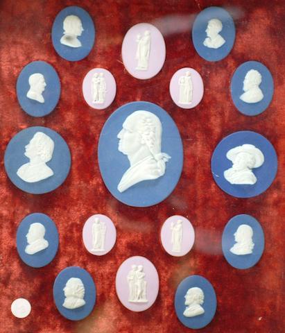 A framed set of seventeen Wedgwood style portrait medallions