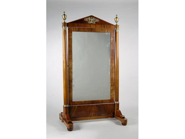 A 19th Century Empire style mahogany and brass mounted cheval mirror,