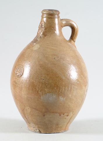 An early 18th Century German stoneware Bellarmine jug
