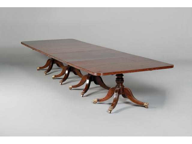 A George III and later mahogany four pillar dining table