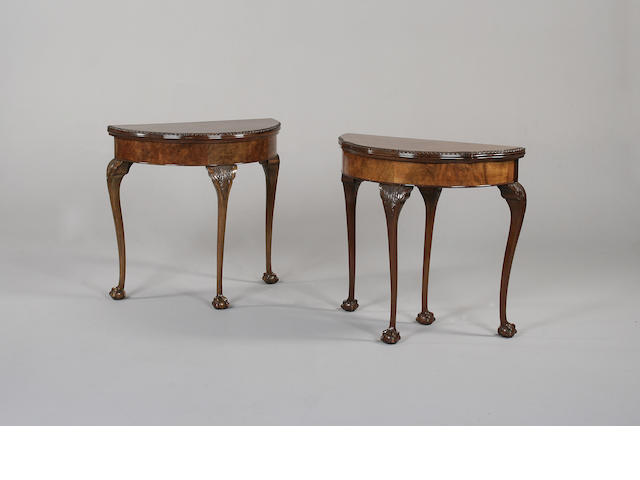 A George I style walnut demi-lune card table