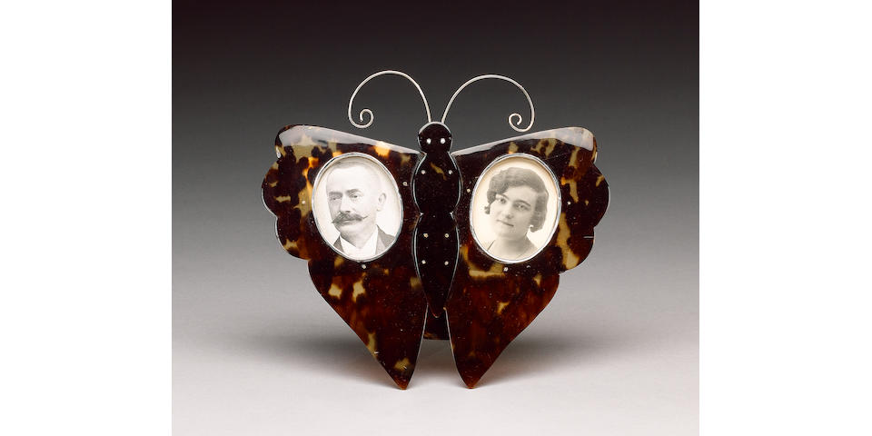 An Edwardian tortoiseshell butterfly double photograph frame,