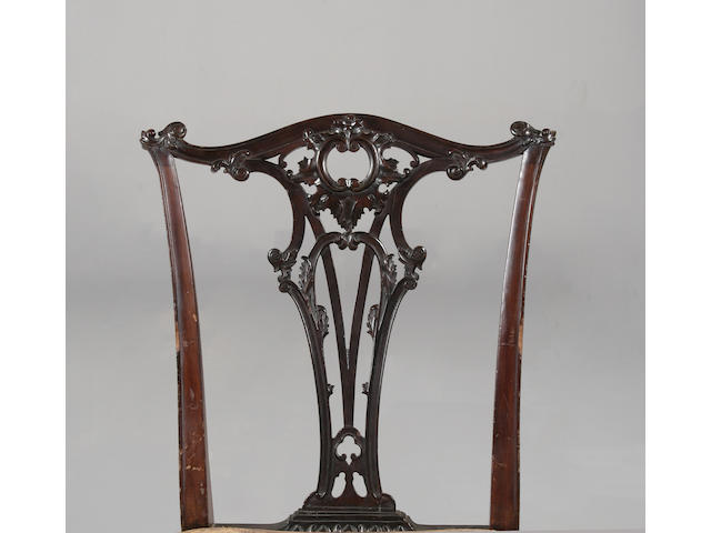 A set of twelve late 19th century mahogany dining chairs