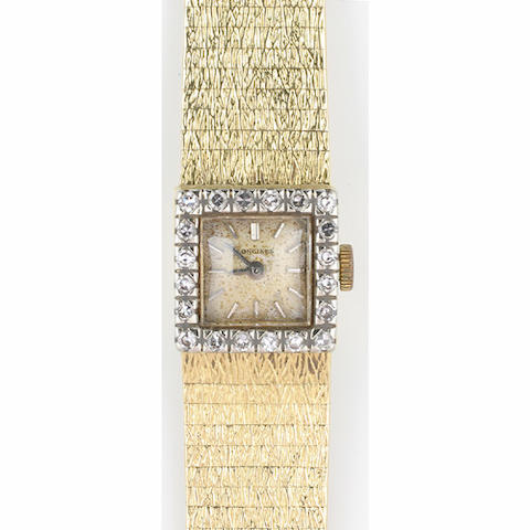 Longines: A lady's diamond set wristwatch