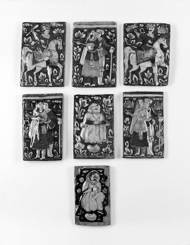 A group of seven Qajar underglaze painted moulded pottery Tiles Persia, 19th Century(7)