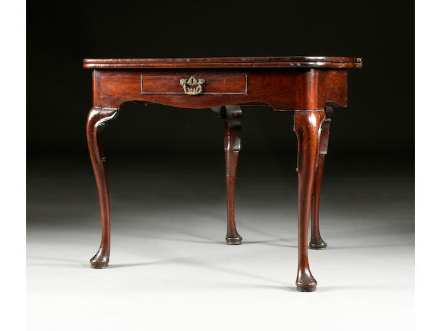 A mid 18th century mahogany fold-over tea table