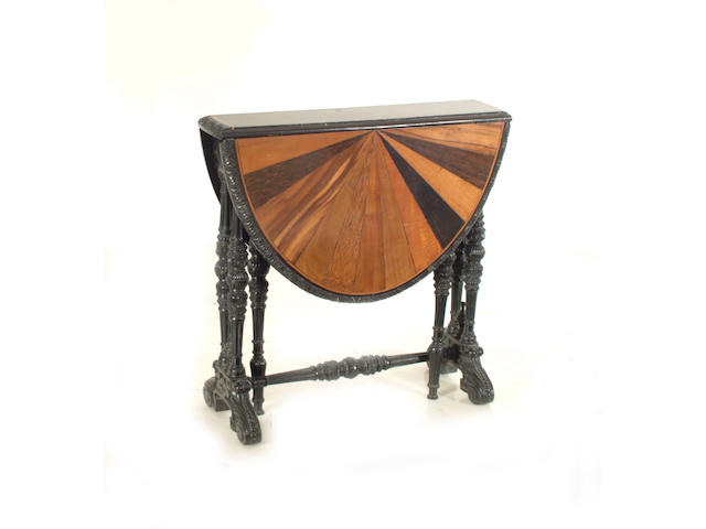 A Ceylonese ebony and specimen wood inlaid oval Sutherland table