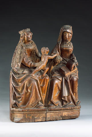 A mid 15th century Flemish (Brussels, Limbourg ?) oak carving of the Virgin and Christ child with Sa