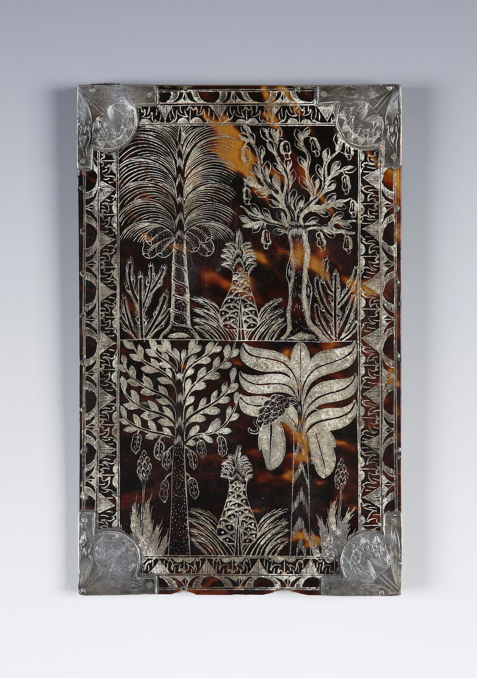 An engraved tortoiseshell and silver mounted comb case, dated 1688