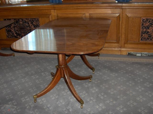 A Regency style mahogany twin pedestal dining table