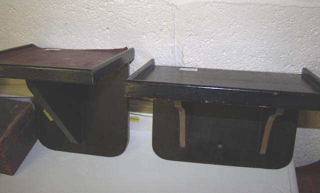 Two ebonized clock wall brackets.