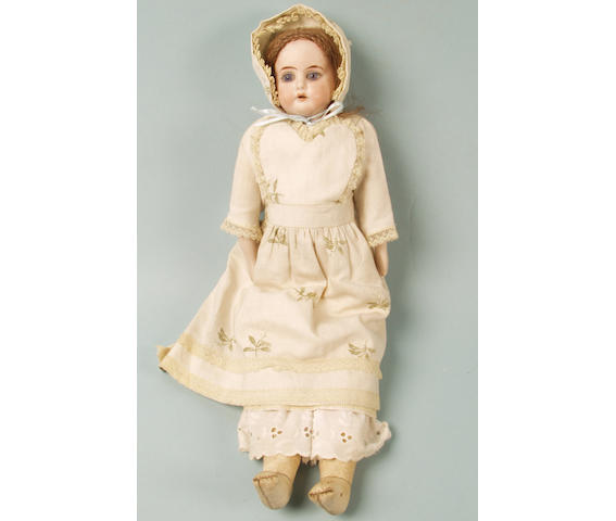 A German bisque head and shoulder doll,