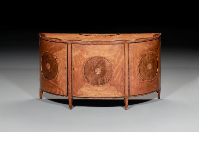 A George III satinwood, bird's eye maple, pollard oak and palisander marquetry demi-lune Commode