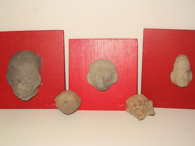 Twelve La Tolita pottery head fragments