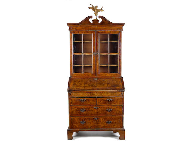 A good Queen Anne walnut crossbanded and featherstrung bureau bookcase
