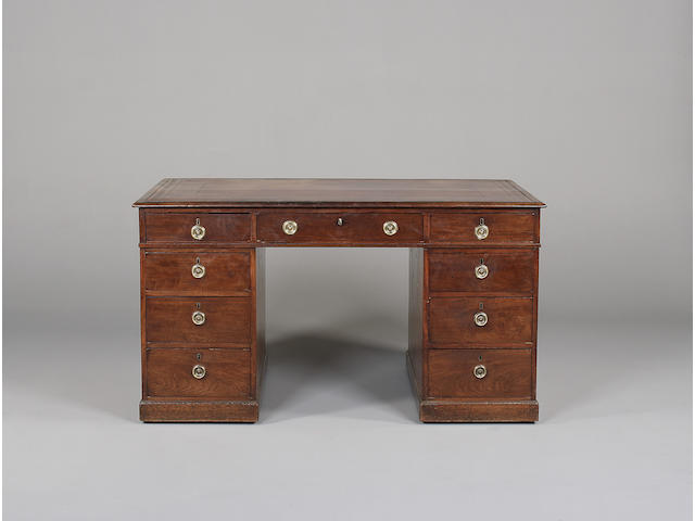 A small late George III mahogany partner's desk