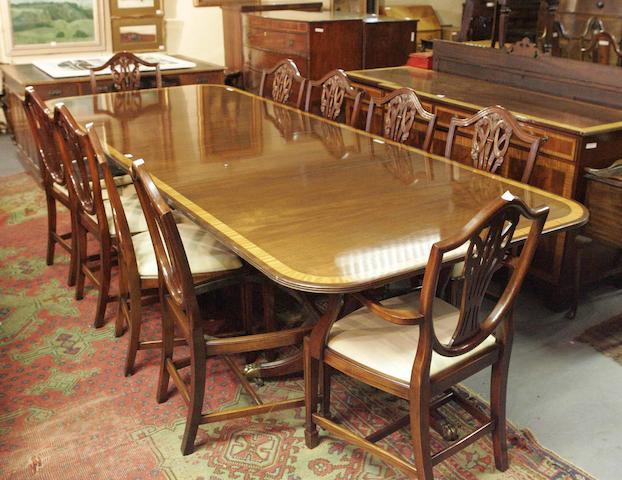 A Regency style twin pedestal dining table
