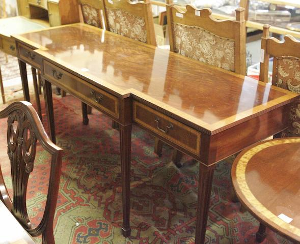 A George III style mahogany and inlaid breakfront serving table