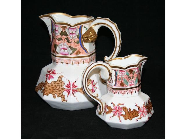Two graduated English porcelain water jugs, circa 1840