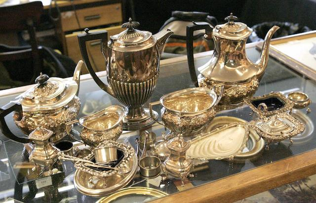 A collection of electroplated items to include a four piece tea service, castors, and other items.
