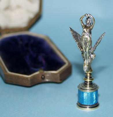 An early 20th century silver gilt and blue enamel seal
