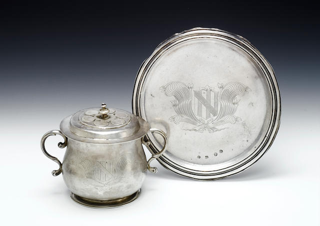 A Charles II silver footed salver and two handled porringer and cover, maker's mark of IA in a dotted circle, London 1679, porringer unmarked,  (4)