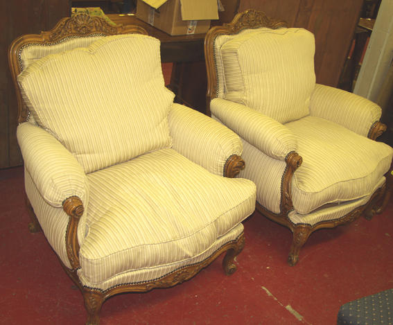 A pair of 18th Century style upholstered armchairs