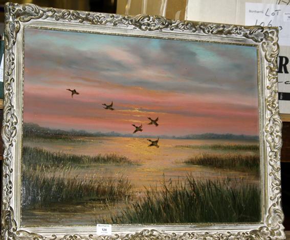H L Braunston sunset scene of ducks over an estuary, framed 45.5cm x 59.5cm.