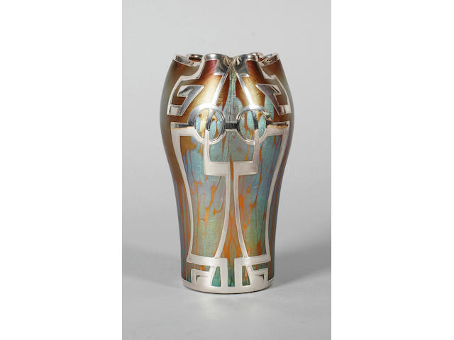 A Loetz iridescent glass vase with metal overlay