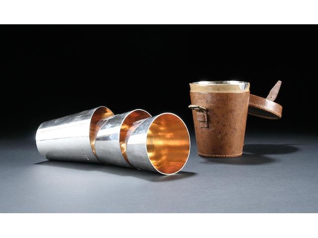 A set of six graduated beakers by Asprey and Company London 1919,