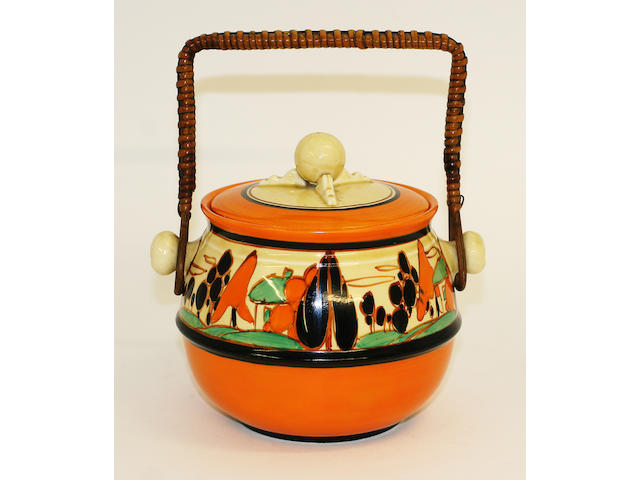 A Clarice Cliff Fantasque biscuit barrel and cover
