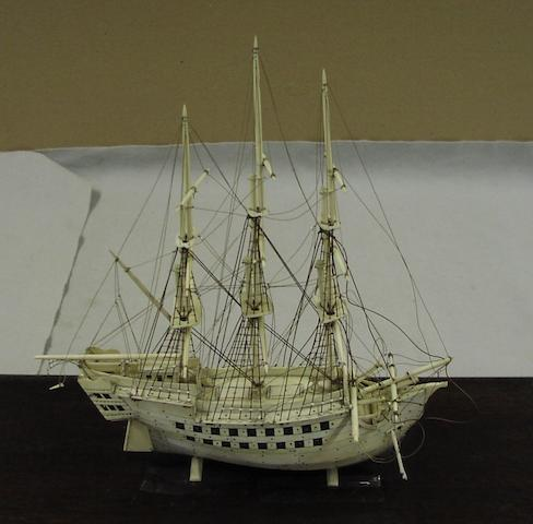 An ivory model of a three masted ship, 60 x 24 x 38cm.