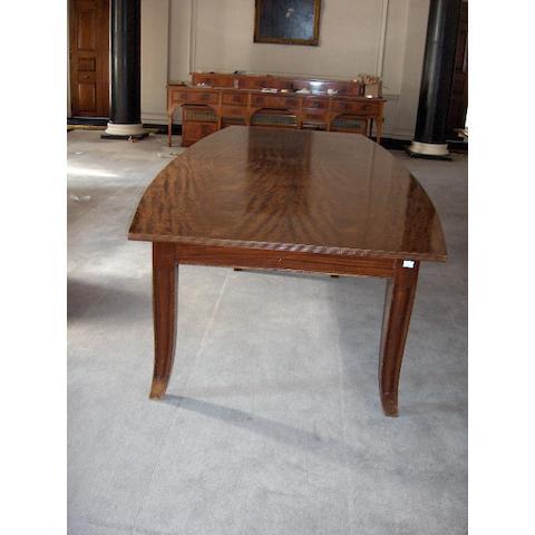 A mahogany quarter veneered board room table