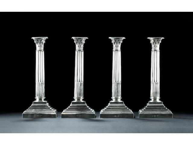 A set of four Corinthian column candlesticks by Walker & Hall Chester 1906,