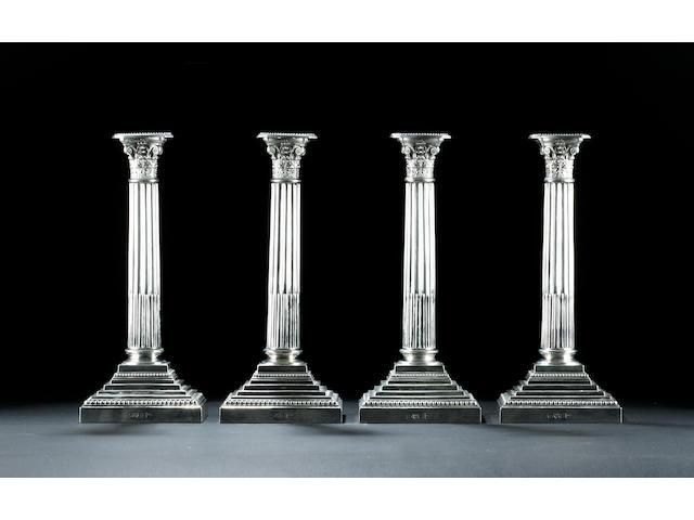 A set of four Corinthian column candlesticks by Walker & Hall Chester 1906,