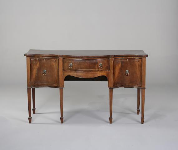 A George III style mahogany serpentine sideboard