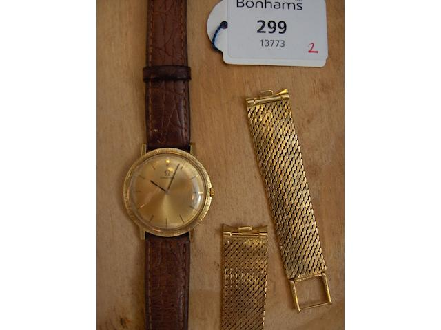 Omega.  An 18 carat gold cased gentleman's wristwatch,(2)