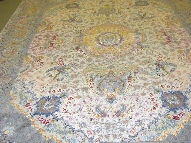 A Tabriz carpet North West Persia, 362cm x 252cm