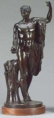 A 19th century French or Italian bronze figure of a semi-clad classical male