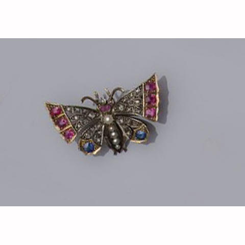 A late Victorian gold and silver mounted diamond, ruby, sapphire and pearl butterfly brooch