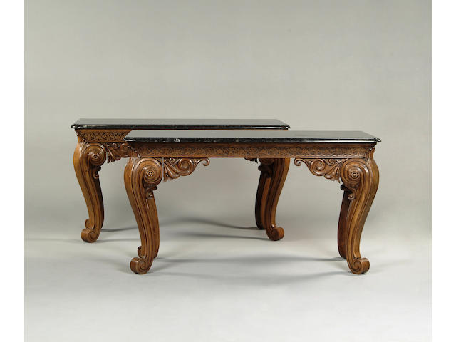 A pair of 18th century style carved beech and oak side tables