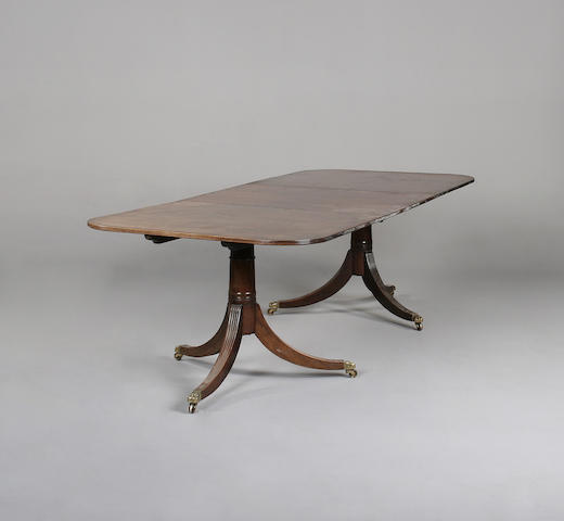 A George III style mahogany and line inlaid twin pedestal dining table