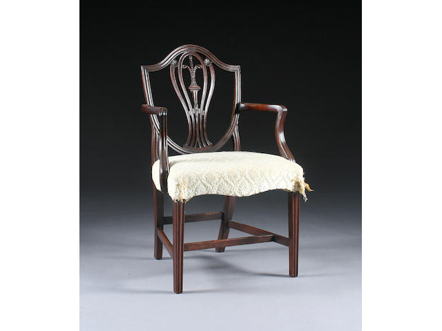 A George III Hepplewhite-style mahogany elbow chair